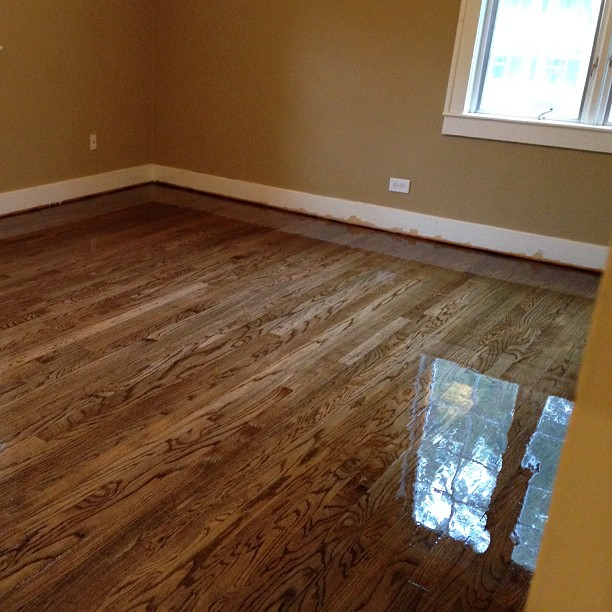 Hardwood floor refinishing with antiquebrown dark for Sanding hardwood floors